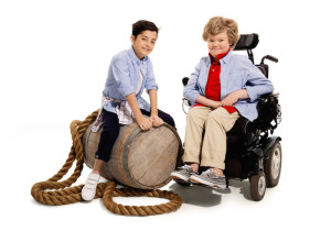Two children, one in a wheelchair, wearing adaptable clothing. Tommy Hilfiger // Credit: Richard Corman